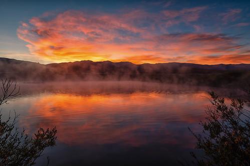 sunrise dawn daybreak clouds reflections mirror pond mist mountains landscape colorado tabernash fraser devilsthumbranch landscapes