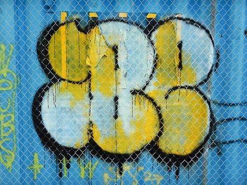 Vancouver Eastside graffiti on a blue dumpster