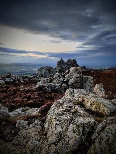 rock sunset stiperstones hill shropshire sky cloud blue grey bracken heather stone jagged high view ancient devils chair