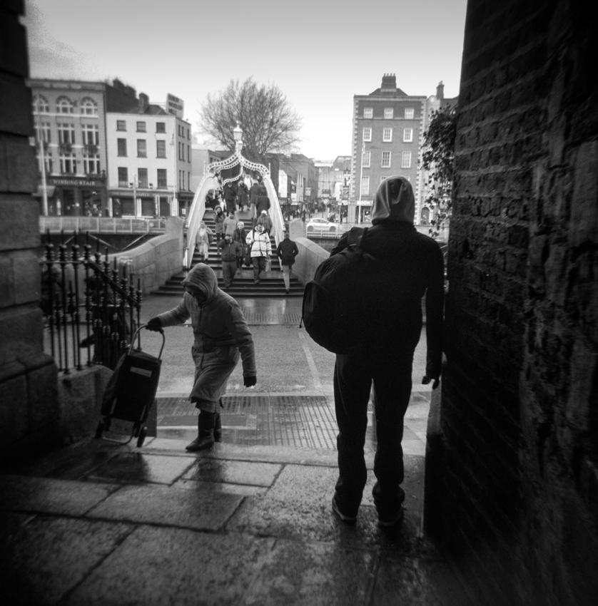 Ha'penny bridge Dublin on a wet and windy day.