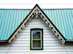 Gingerbread, green roof, rust, flagpole, window, Christmas lights, white siding and sky