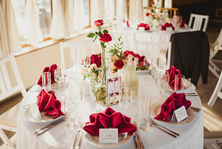 Wedding Table Serving Indoors With Red Roses | by wuestenigel