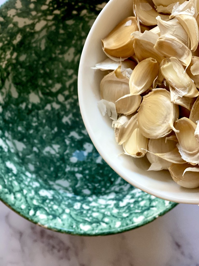 Start by removing the outer layer of garlic skin. Follow our guide to peeling garlic.