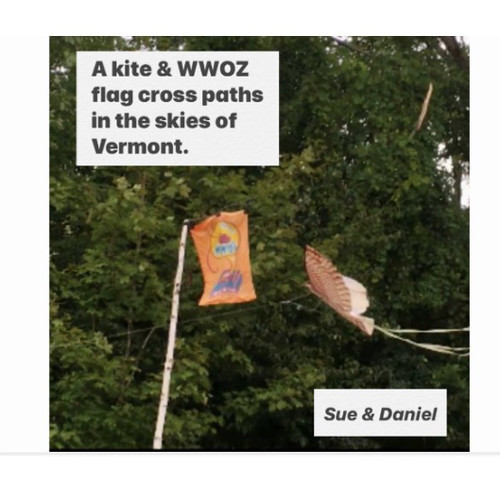 Sue and Daniel fest with a kite & WWOZ flag that meet in the skies of Vermont.