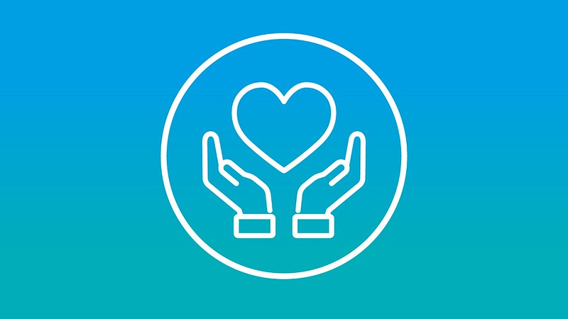 A logo of two hands holding a heart on a blue background