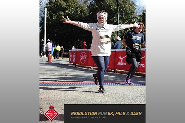 Jennifer Mashburn running with arms out wide
