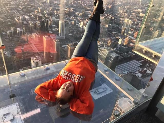 Jennifer Mashburn in an Auburn sweatshirt at the Willis Tower Skydeck in Chicago