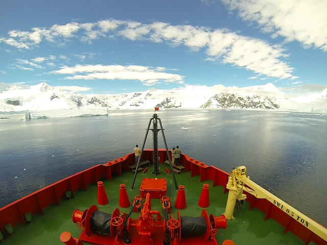Scientists on a boat at sea off the coast of Antarctica