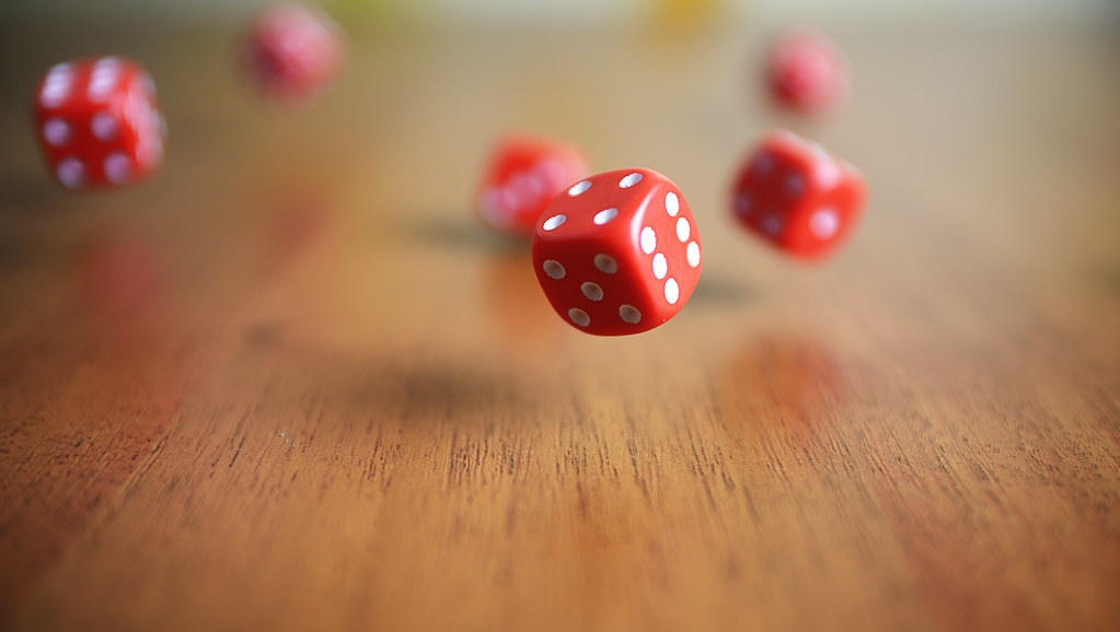 red dice falling onto a table