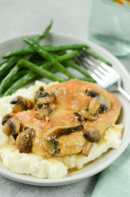Chicken Marsala - pan fried chicken breasts and mushrooms in a rich marsala sauce. Serve over mashed potatoes to soak up all the sauce!