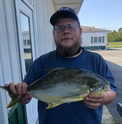 Photo of angler David Schrock holding his Maryland state record Florida pompano