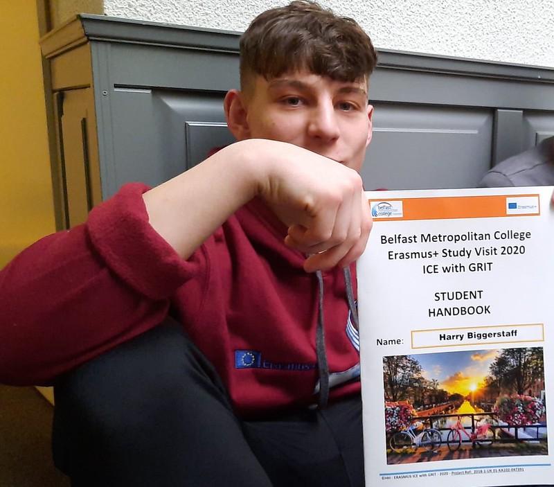 Belfast Met student holding his certificate