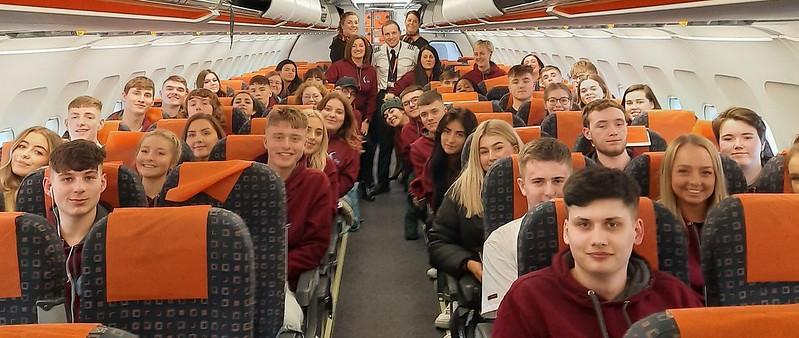 Belfast Met college students on a plane
