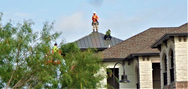 MEN ON THE JOB------ON THE ROOF