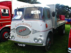 robertknight16 posted a photo:	ERF KV Series Flatbed (1962)Livery Chandler Transport. Radnorshire, Mid-WalesOwner M Chadler, Llandrindod WellsRegistration Number 7240 SV (Edinburgh)ERF ALBUMwww.flickr.com/photos/45676495@N05/albums/72157623665035629The KV was a radical change for ERF, designed by Dennis Foden who had recenctly become Managing Director, along with Gerald Broadben of Sandbach coachbuilders J H Jennings  and the ERF Chief Engineer Ernest Sherratt the new Kleer Vue cab (KV) was heralded as a futuristic design with its use of curved glass, on of the first applications in the truck industry and one that created challenges for glass manufacturer Triplex.. It prove popular with operatorswith its rounded shape and trusty Gardner engine Thankyou for a massive 54,531,272  views Shot 29.08.2016 at the Shrewesbury Steam Fair  REF 121-021