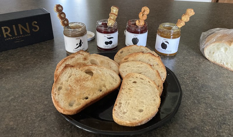 Jams and breads, ready to be consumed.