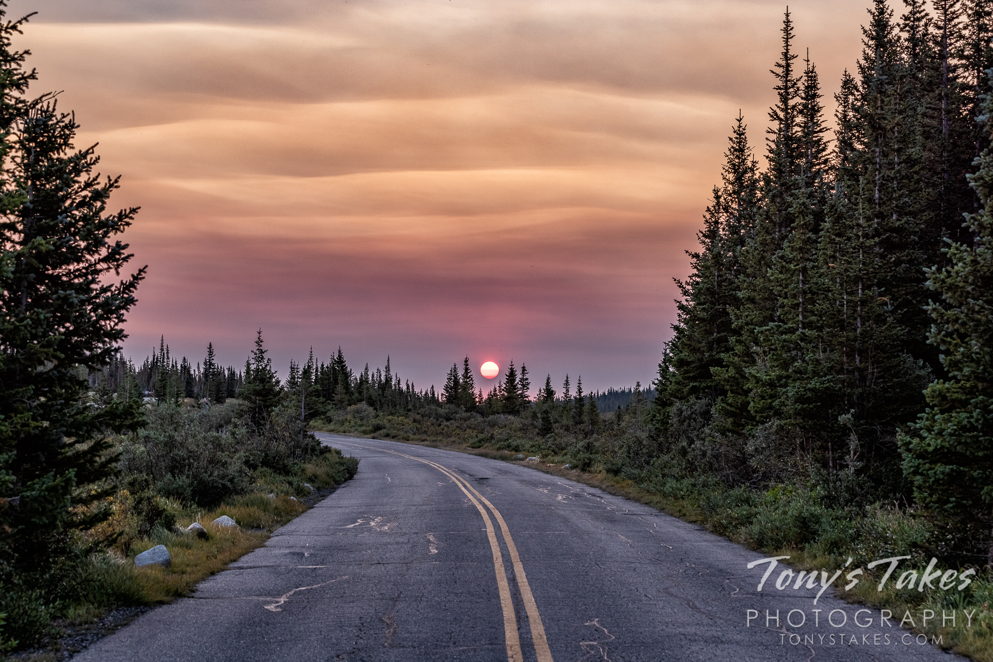 Smoky sunrise along a high country road