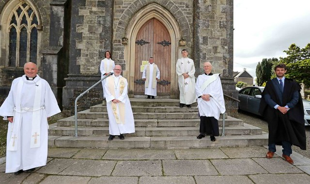Clergy and the Diocesan Registrar, John Jerymn, following the service of ordination at St Peter's, Bandon.