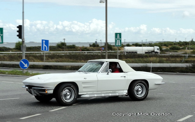 Lucky snap on the move of 1964 Chevy Corvette Stingray in Denmark with Sweden on the horizon on other side of that water
