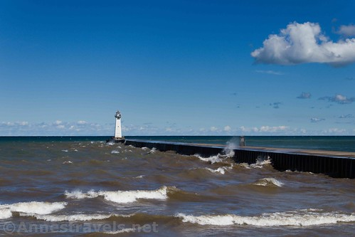 The pier and lighthouse from the parking lot at Sodus Point Beach Park, New York