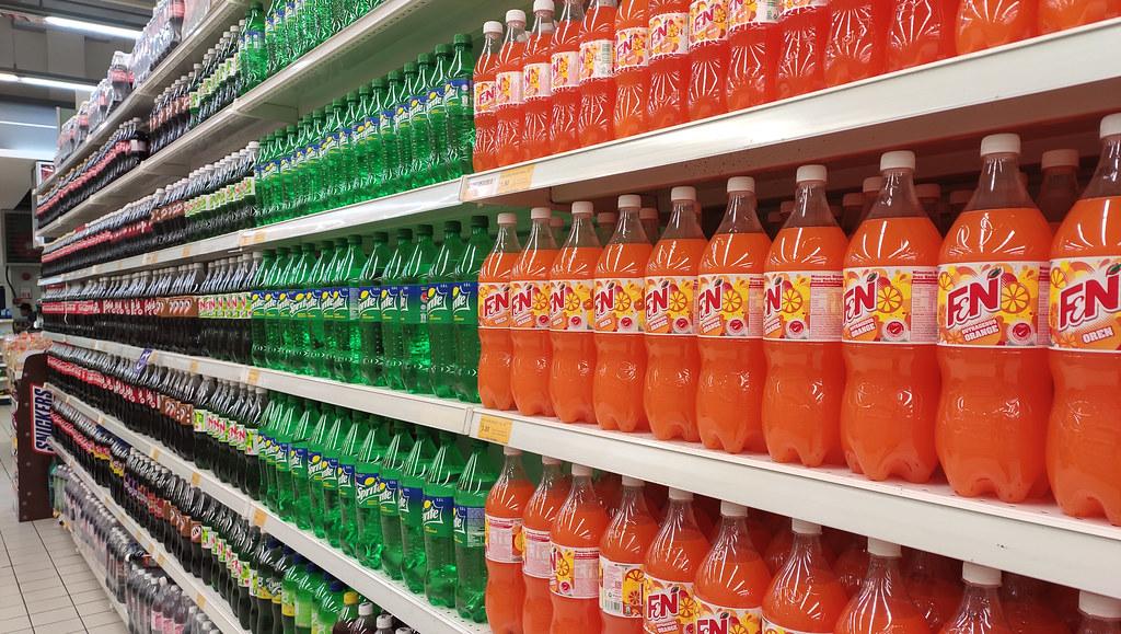Fizzy drinks on supermarket shelves.