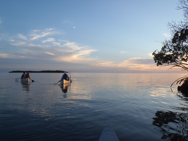 Veterans group canoeing at sunset