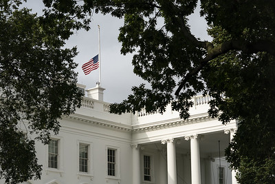 The United States Flag Flies at Half-Staff Atop the White House