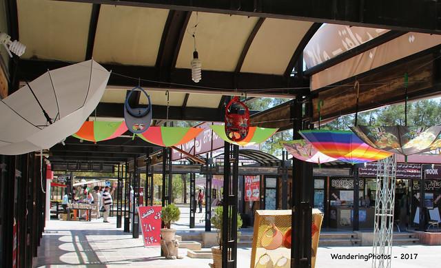 Hanging upside down Umbrellas around the shops - Persepolis Iran