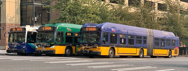 King County Metro 2011 New Flyer DE60LFR 6875, with 2016 XDE60 8016 and Sound Transit 2012 D60LFR 9812K