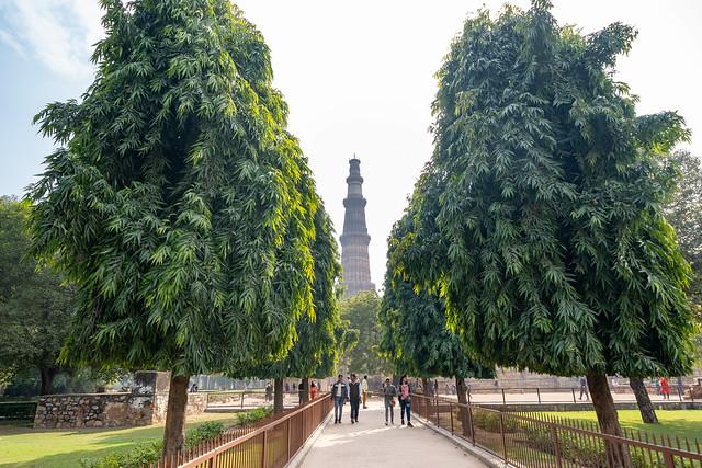 New Delhi, India - January 5, 2020: Tourists enjoy Qutub Minar complex and ruins