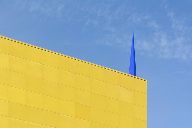 Yellow building, blue needle