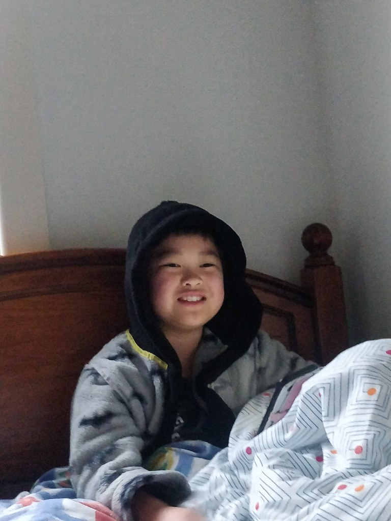Isaac playing Roblox in bed on a Sunday morning