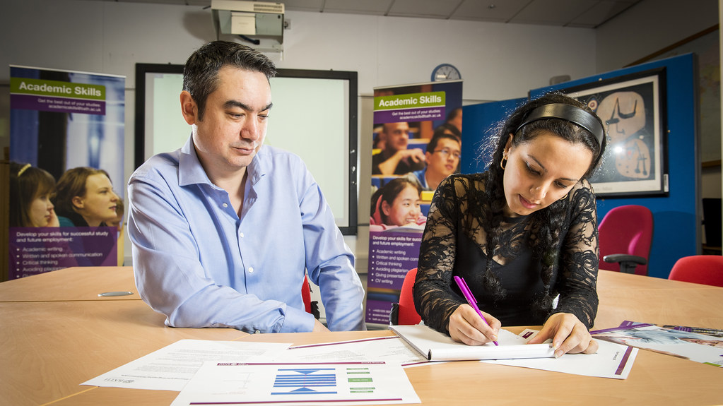 Student taking part in a one-to-one writing tutorial with a Skills Centre writing tutor