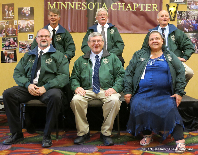 National Wrestling Hall of Fame, Minnesota Chapter 2020 Class. Front (L-R): Tom Beyer, Mike Bredeck (representing Father Otto Weber), and Mary Davis. Back (L-R): Mark Jensen, Bud Heidgerken, and Don Kuusinen. Not pictured: Brian Bakke, Larry Goodnature, a