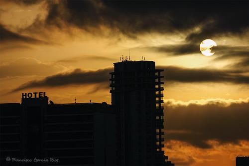 calpe costablanca alicante spain sky sun orange summer sunrise dawn hotel buildings outdoors morning clouds vacation holidays cityscape skyline landscape light recesvintus