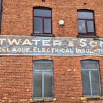 Faded sign at Attwaters in Preston