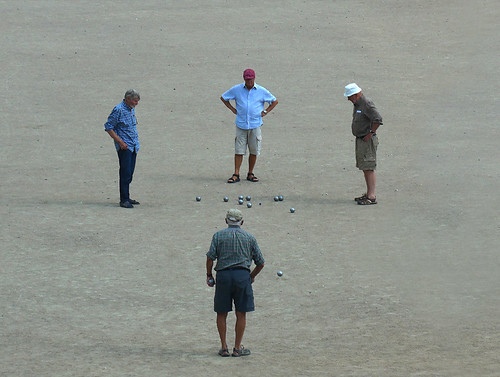 Four men play a game of boules in Aarhus, Denmark