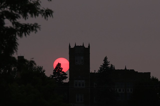 Hazy sunset behind old school in Jefferson, WI