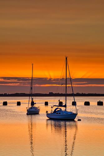 langstone langstoneharbour boats oldbillyrailsupports sunset sunsetsky wetreflections