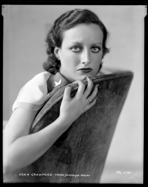Joan Crawford imparts a pretty intense stare in a studio portrait by Clarence Sinclair Bull, ca. 1930(?).