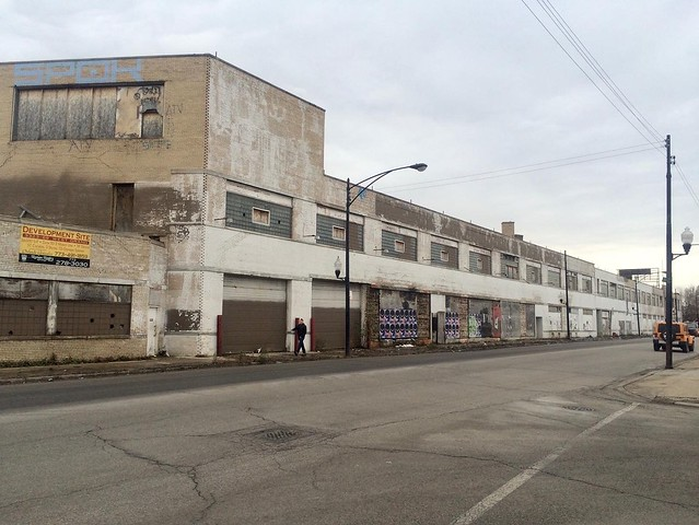 The long demolished Mr. Norm's Grand Spaulding Dodge/Victory Church building. When I was here in 2015 it mostly was a hanging out for the homeless and junkies.