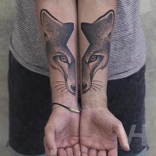 Beautiful Split Animal Hand Tattoo
