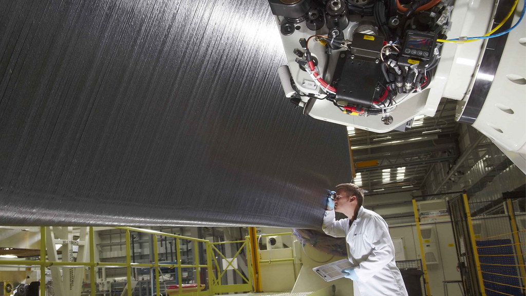 A worker at GKN inspects an area of wing during production.