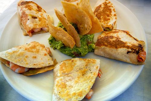Shrimp & cheese quesadillas with guacamole on the beach at Puerto Escondido, Mexico