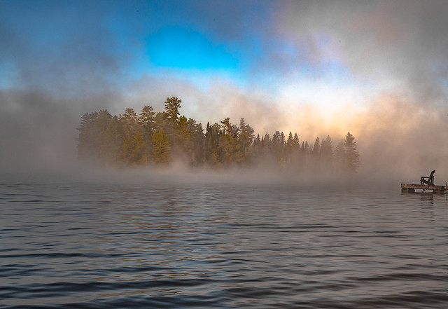 ISLAND IN FOG AT SUNRISE