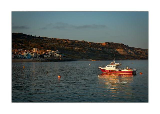 Fishing boat moored up in Cobb Harbour, Lyme Regis ...