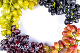 Frame from grapes of different varieties, top view | by wuestenigel