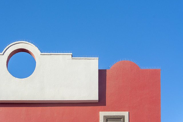 Red and white facade with gap