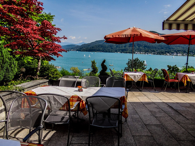 Dining tables with majestic view of Lake Wörth in Carinthia, Austria.