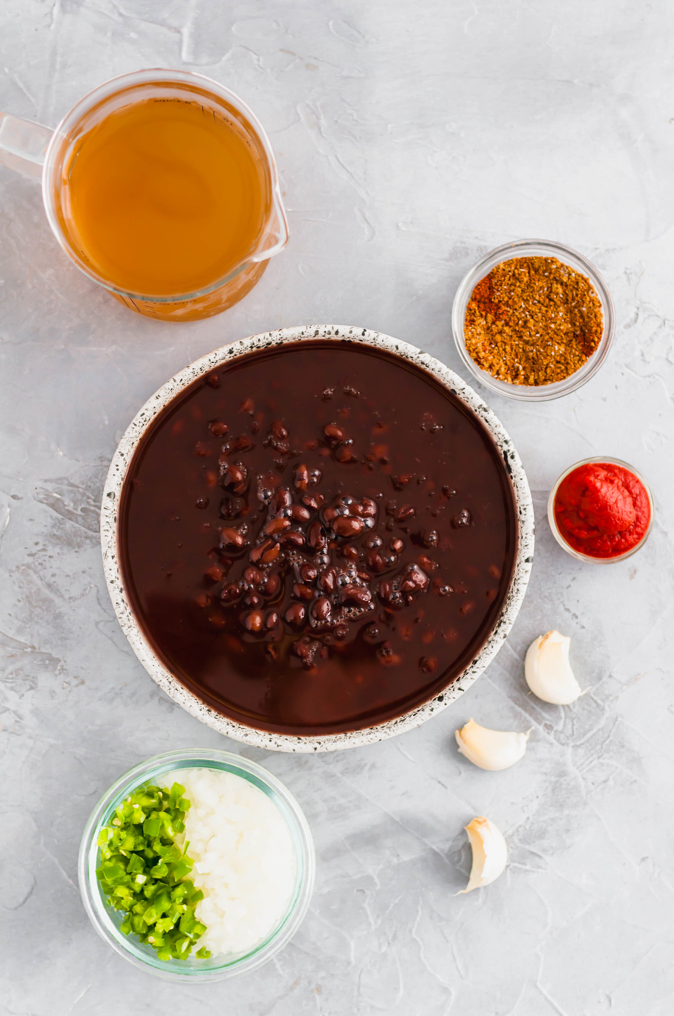 Don't let the falling temperatures bring you down. This Spicy Black Bean Soup is just what you this fall and winter to keep you warm and cozy.